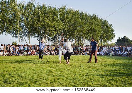 Istanbul Turkey - July 31 2016: Central Asian Turkmen wrestling. in Zeytinburnu district of Istanbul Turkmen wrestling sports events held in the coastal meadows. Turkmen Uzbek Afghan Turkish Turkmenistan Kazakhstan Turkey and other Central Asian youth are