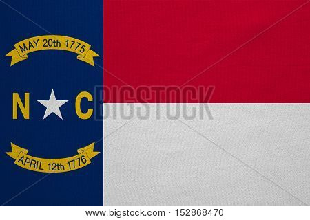 Flag of the US state of North Carolina. American patriotic element. USA banner. United States of America symbol. North Carolinian official flag detailed fabric texture illustration Accurate size color