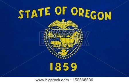 Flag of the US state of Oregon. American patriotic element. USA banner. United States of America symbol. Oregonian official flag with real detailed fabric texture illustration. Accurate size colors