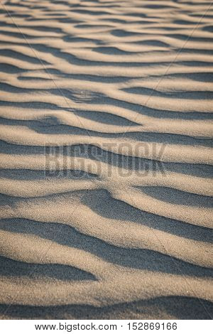 Sand texture on the beach - abstract nature background.