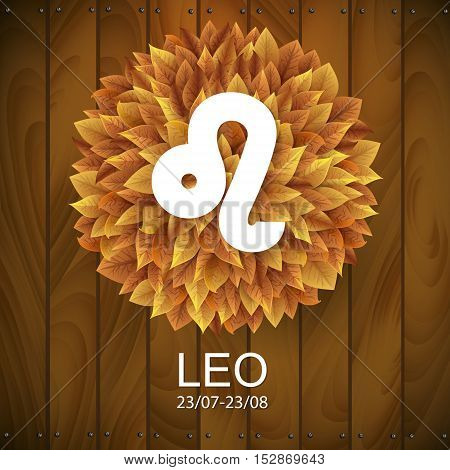 Sign of the zodiac. Leo horoscope. white sign with a circle of autumn leaves. Wooden planks background.