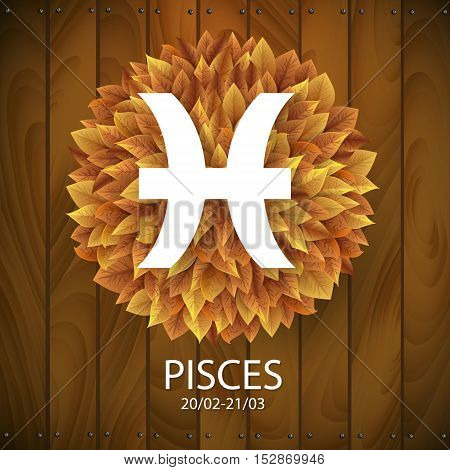 Sign of the zodiac. Pisces horoscope. white sign with a circle of autumn leaves. Wooden planks background.