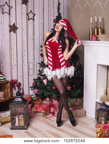 Beautiful Woman Near The Fireplace In Winter House. Selebrating Christmas, Studio