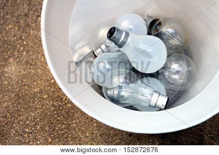Inefficient Tungsten Light Bulbs Discarded In A Trash Can - Green Eco Concept