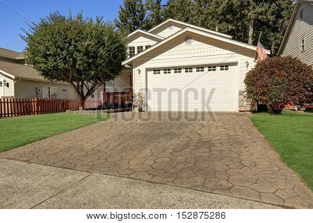 House Exterior. Close Up Of Garage Door With Driveway