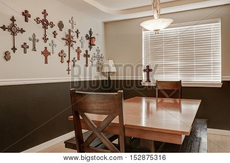 Pastoral Style Dining Room. Crosses Hanging On The Wall