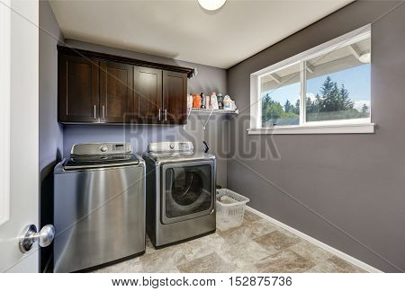 Grey Laundry Room With Modern Stainless Steel Appliances