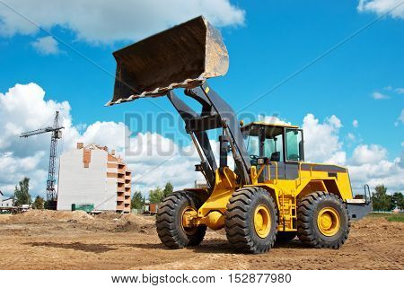 wheel loader at sandpit during earthmoving works