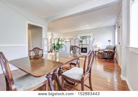 Dining Room And Living Room Interior With Carved Wooden Furniture