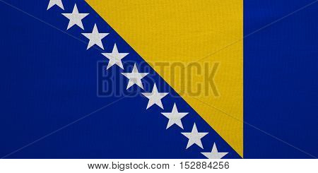 Bosnian and Herzegovinian national official flag. Patriotic symbol banner element background. Correct color. Flag of Bosnia and Herzegovina real detailed fabric texture accurate size illustration