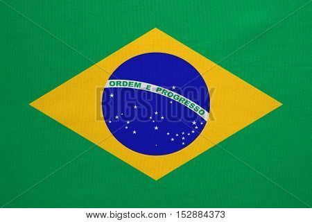 Brazilian national official flag. Patriotic symbol banner element background. Correct colors. Flag of Brazil with real detailed fabric texture accurate size illustration