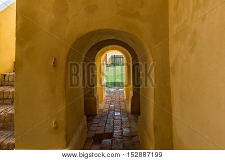 Small arched passageway to the center courtyard in fortress