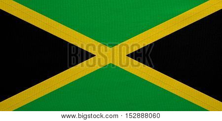 Jamaican national official flag. Patriotic symbol banner element background. Correct colors. Flag of Jamaica with real detailed fabric texture accurate size illustration