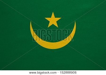 Mauritanian national official flag. African patriotic symbol banner element background. Correct colors. Flag of Mauritania with real detailed fabric texture accurate size illustration