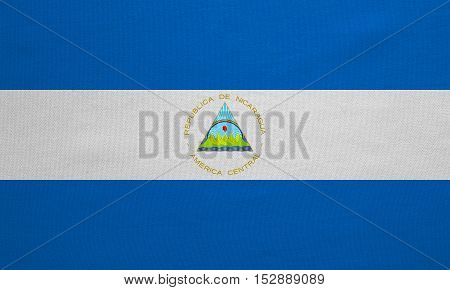Nicaraguan national official flag. Patriotic symbol banner element background. Correct colors. Flag of Nicaragua with real detailed fabric texture accurate size illustration