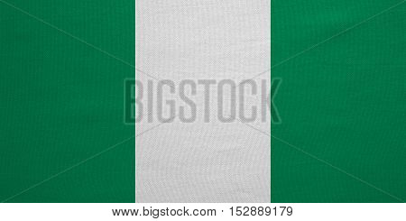 Nigerian national official flag. African patriotic symbol banner element background. Correct colors. Flag of Nigeria with real detailed fabric texture accurate size illustration