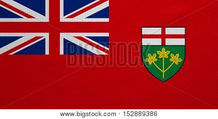 Ontarian provincial flag patriotic element and official symbol. Canada banner and background. Correct colors. Flag of the Canadian province of Ontario real fabric texture accurate size illustration