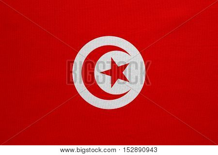 Tunisian national official flag. African patriotic symbol banner element background. Correct colors. Flag of Tunisia with real detailed fabric texture accurate size illustration