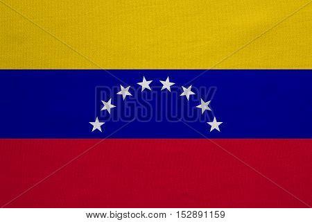 Venezuelan national official flag. Bolivarian Republic of Venezuela patriotic symbol banner element background. Correct color. Flag of Venezuela with real fabric texture accurate size illustration