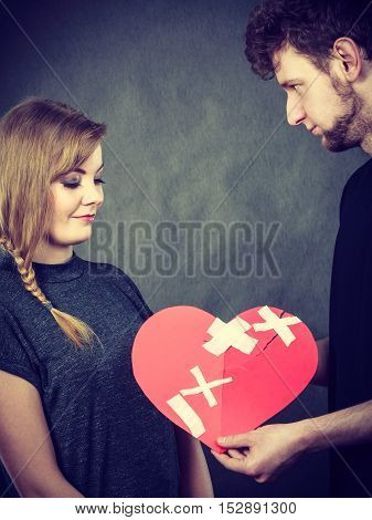 Couple Holds Broken Heart Joined In One
