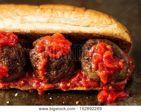 close up of rustic american italian meatball sandwich