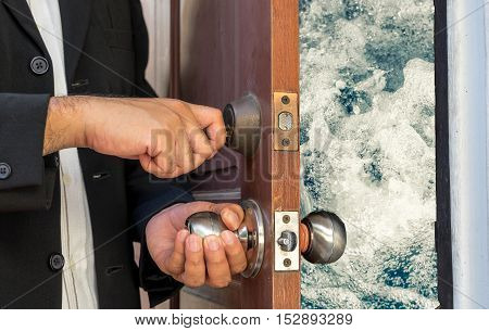 businessman open the door by key to water splash - can use to display or montage on product