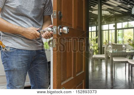locksmith open the wood door by cylinder tools to restaurant - can use to display or montage on product