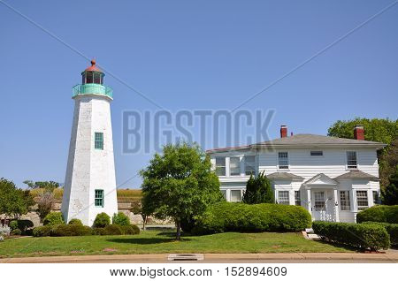 Old Point Comfort Lighthouse and keeper's quarters in Fort Monroe, Chesapeake Bay, Virginia, USA.