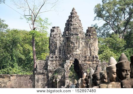 Faces belong to the bodhisattva or diety on the gate of Angkor Thom,Siem Reap,Cambodia.