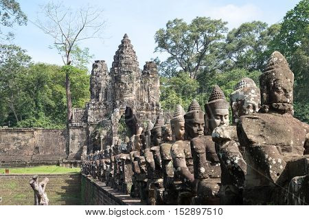 Deva or deity row at entrance of Angkor Thom, Siem Seap, Cambodia.