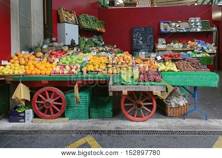 LONDON UNITED KINGDOM - NOVEMBER 20: Borough Market in London on NOVEMBER 20 2013. A Variety of Fruits and Vegetables for Sale in Cart at Borough Market in London United Kingdom.