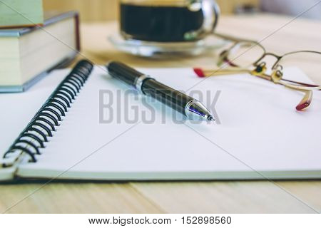Put Pen On Blank Notebook Near Glasses.