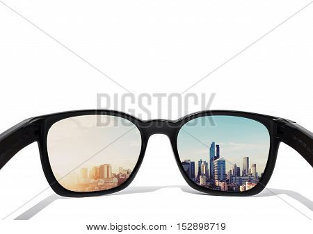 Eye glasses, isolated on white background, with city view in lens