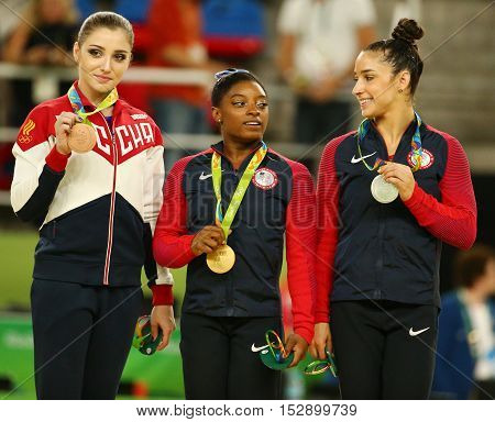 RIO DE JANEIRO, BRAZIL -AUGUST 11, 2016:Women's all-around gymnastics medalists at Rio 2016 Olympic Games Aliya Mustafina of Russia (L),Simone Biles of USA and Aly Raisman of USA during medal ceremony