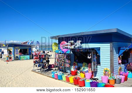 WEYMOUTH, UNITED KINGDOM - JULY 18, 2016 - Tourist shop and ice cream hut on the beach Weymouth Dorset England UK Western Europe, July 18, 2016.