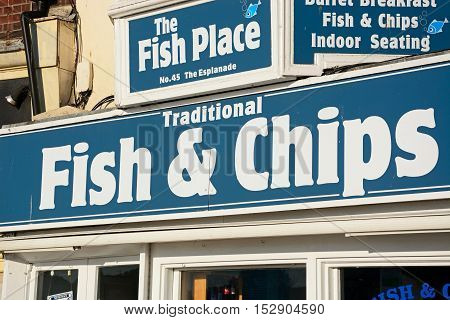 WEYMOUTH, UNITED KINGDOM - JULY 19, 2016 - Traditional fish and chips shop sign along the Esplanade Weymouth Dorset England UK Western Europe, July 19, 2016.