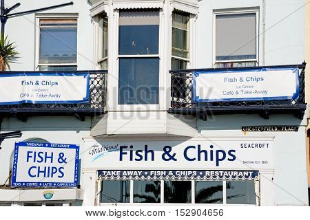 WEYMOUTH, UNITED KINGDOM - JULY 19, 2016 - Traditional fish and chips shop signs along the Esplanade Weymouth Dorset England UK Western Europe, July 19, 2016.