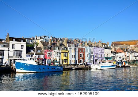WEYMOUTH, UNITED KINGDOM - JULY 19, 2016 - View of fishing boats and quayside buildings in the harbour Weymouth Dorset England UK Western Europe, July 19, 2016.