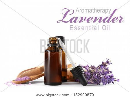 Spa composition with essence, closeup. Text AROMATHERAPY LAVENDER ESSENTIAL OIL on white background. Spa beauty concept.