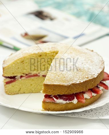 Victoria sponge cake with butter cream and strawberry