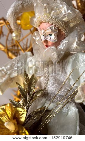 The court jester in carnival costume,Christmas background