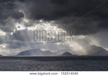 Sunbeams at a fjord near Alesund Norway
