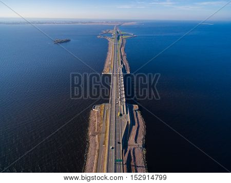 Aerial view of dam in St. Petersburg. She runs through the Gulf of Finland and connects the city of Kronstadt and Saint Petersburg. The dam moving vehicles.