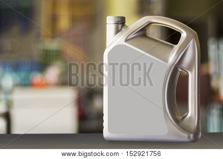 Plastic canister with blank label in a blurred background