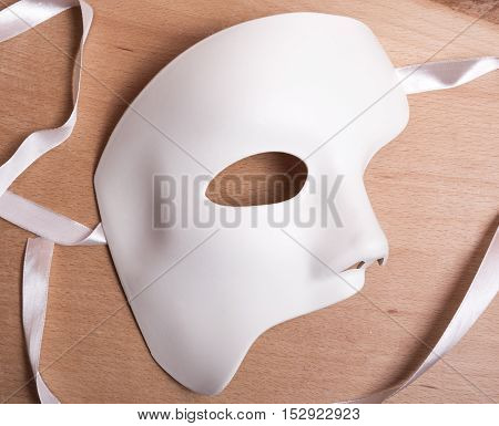 White Scary Halloween Mask On Wooden Background.