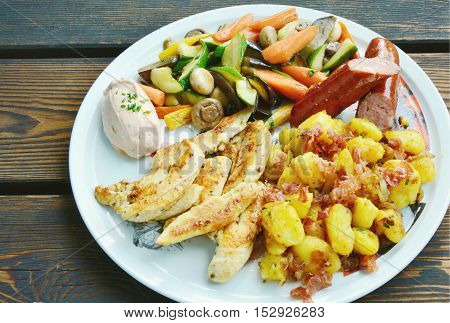 Grilled chicken breast and sausage with variety vegetable.