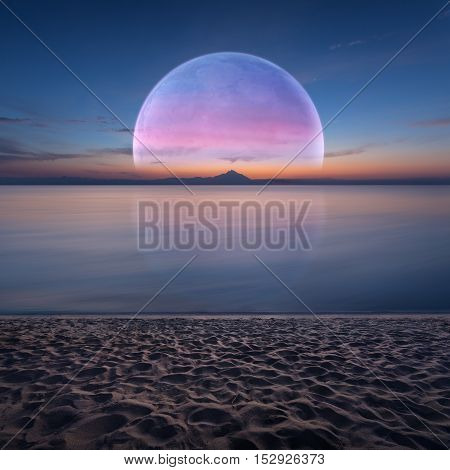 Idyllic seascape at dawn with big moon rising over horizon and sandy beach. Fantasy and dream concept.