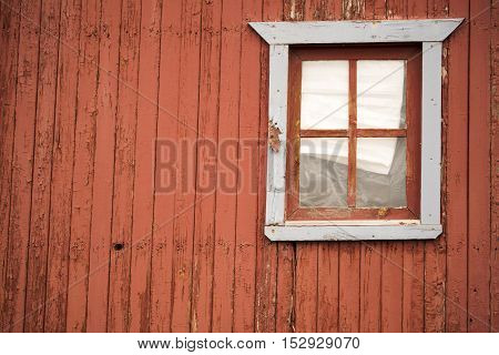 A window on a rustic mountain cabin in Cripple Creek Colorado