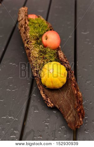 Nature mort with apple and pumpkin on a table