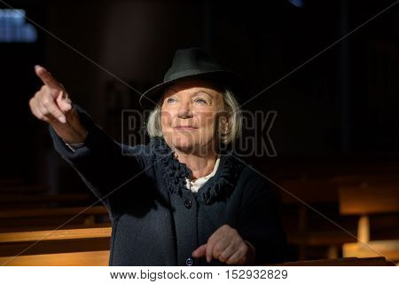 Bereaved Elderly Lady Praying In A Church
